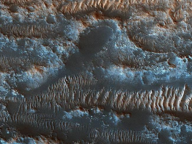 MRO also snapped this incredible image of the moving sand ripples of Lobo Vallis, a region on Mars named after a river on the Ivory Coast, in April. Picture: NASA