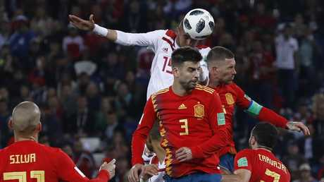 Youssef En Nesyri outjumps the Spanish defence to power home his header. Picture: AP.