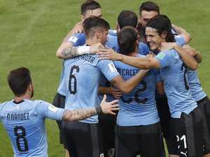 Russia humbled as Uruguay surge into final 16