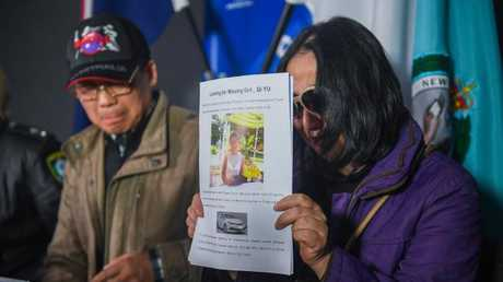 Parents of missing woman Qi Yu, Qing He (right) and Zhihe Yu (left). Picture: Brendan Esposito
