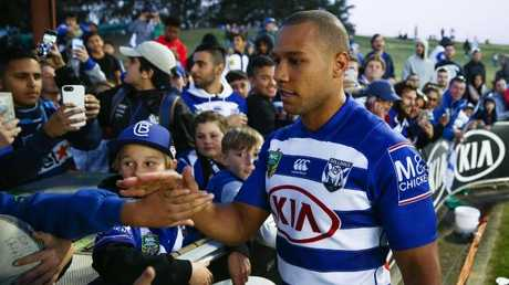 Moses Mbye played his final game for the club against the Titans in Round 15. (AAP Image/Brendon Thorne)