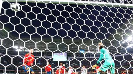 David De Gea can only watch as Youssef En Nesyri sends Morocco into a short-lived lead.