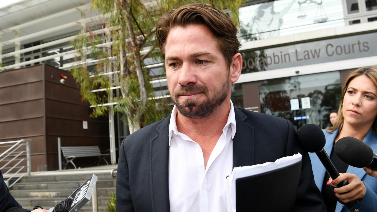 Former North Melbourne premiership player Shannon Grant leaves Moorabbin Magistrates Court.