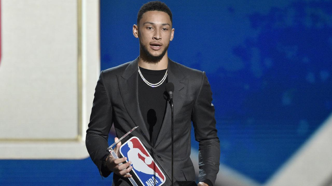 Ben Simmons accepts his rookie of the year award.