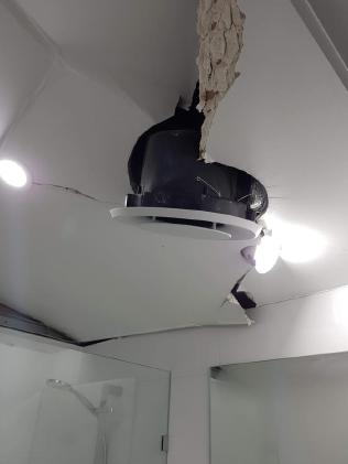 The explosion damaged the ceiling in the bathroom.