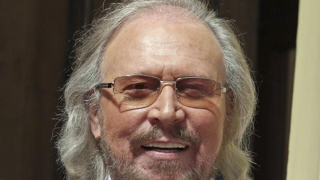 Singer and songwriter Barry Gibb arrives at Buckingham Palace.