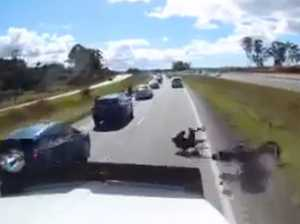 Dash cam captures Bruce Hwy motorcyclist almost hit by truck