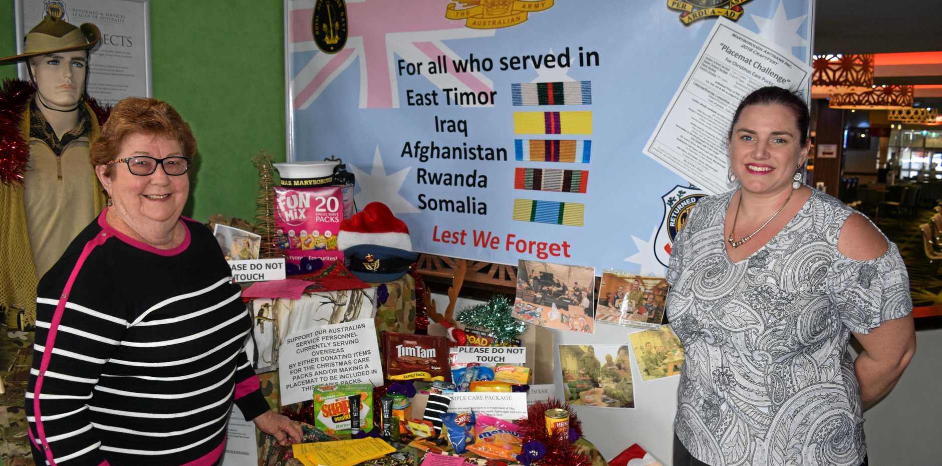 Maryborough Artisan Lesley Mason and Maryborough RSL sub-branch secretary Ebony Blackwood invite club patrons to inspect and ask questions about the Craftfest Challenge and Troops Care Package donations display in the Lennox St foyer.