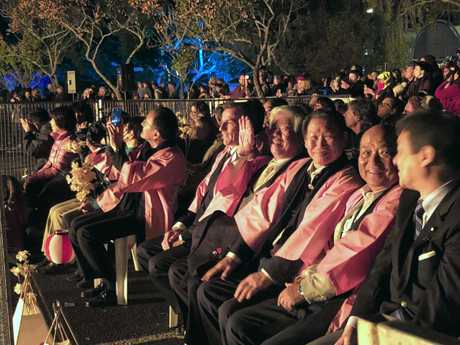 GLOWING: The delegation from Lismore's sister city Yamato Takada basks in the heat of the fireworks at Lismore Lantern Parade.
