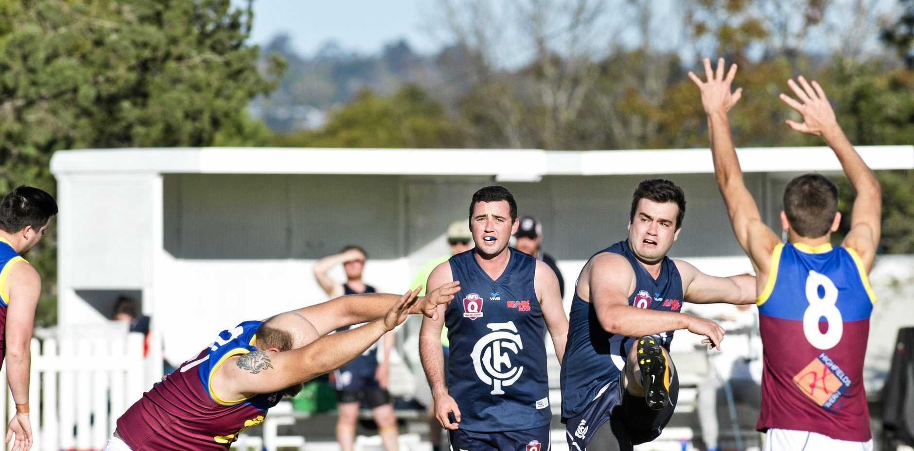 COMPLETE DOMINANCE: Brent Watkins kicks downfield during Coolaroo's 32.18 (210) to 9.4 (58) win over Highfields at the weekend. It was one of four games with a winning margin of more than 137 points.
