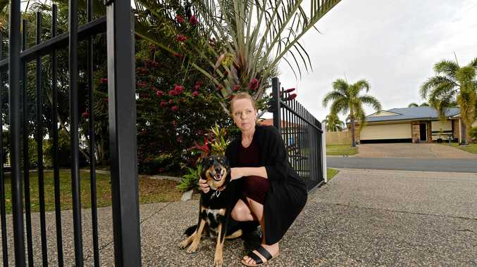 FEARFUL OF FERALS: Leonie Leonard with her dog Sammy at home in Glenella.