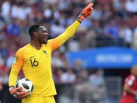 France's goalkeeper Steve Mandanda gestures. Pic: AFP