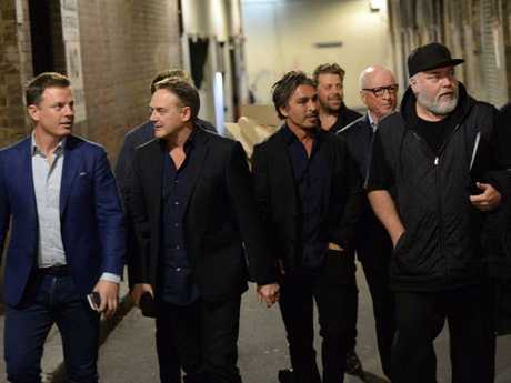 John (second from right) with Kyle Sandilands, Ben Fordham and friends on the street outside his book launch last year.