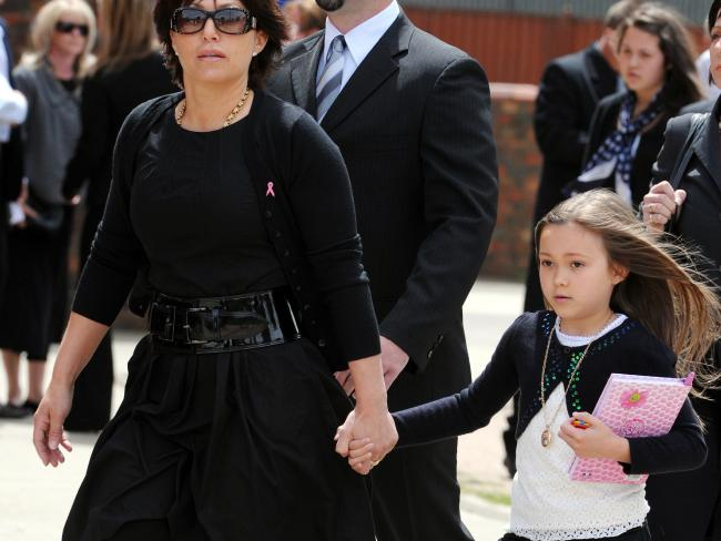 Dhakota and mother Roberta Williams at the funeral of the girl's grandmother Barbara in 2008.
