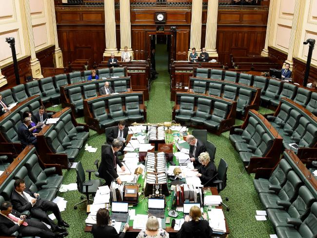 Bleary eyed MPs in Victoria debating voluntary euthanasia laws throughout the night during a marathon session of State Parliament in October last year. Picture: Nicole Garmston