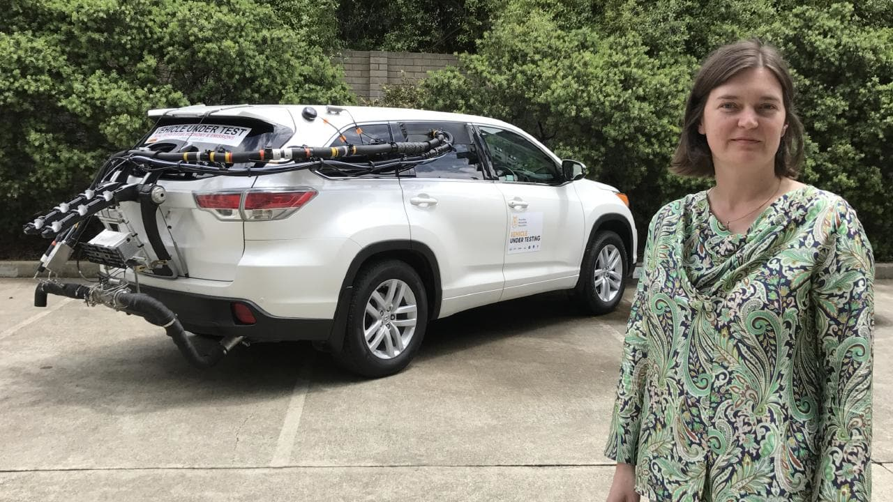 Vehicle emissions expert Natalie Roberts with a Toyota Kluger fitted with test equipment that measures fuel economy and emissions on public roads, rather than in a laboratory. Picture: Joshua Dowling.
