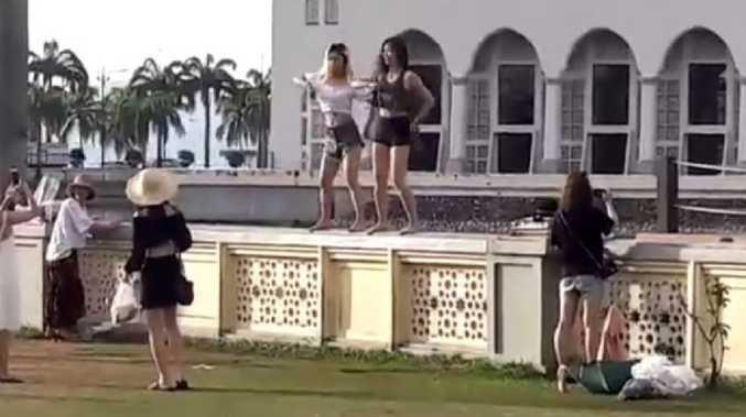 Authorities in Malaysia were angry after a video emerged showing tourists dancing inappropriately outside a popular mosque. Picture: Sabah Info