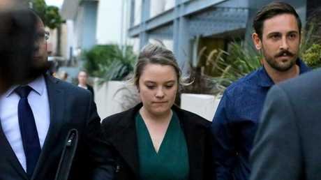 Amy Crisp (centre) and partner Michael Stead (right) leave the coroner's inquest.