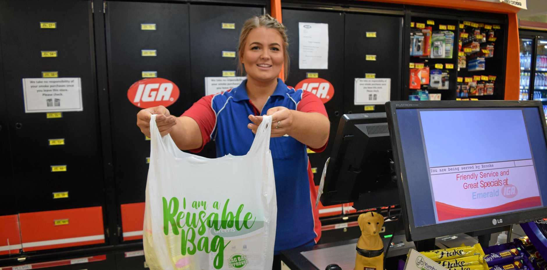 BAGGING PLASTIC: Emerald IGA employee Holly Wilson with their new 10 cent reusable bags.