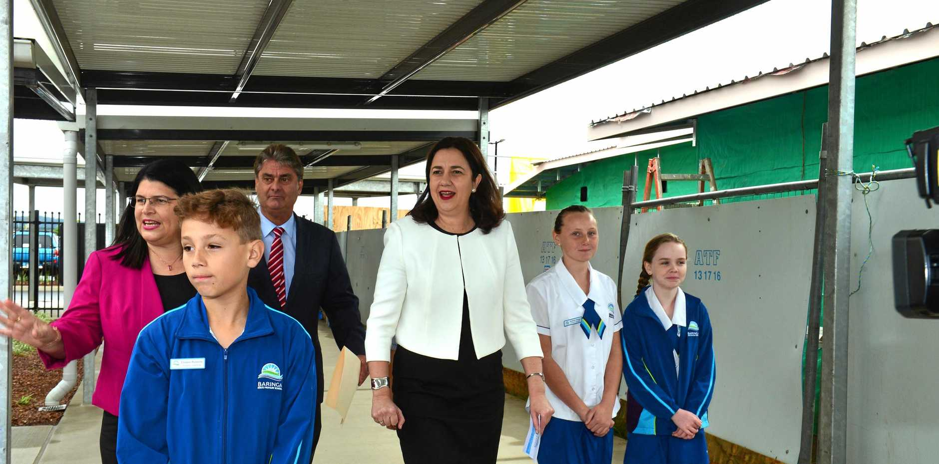 Touring Baringa State Primary School before its official opening ceremony are (from left) education minister Grace Grace, student Cooper Roberts, principal Noel Baggs, Premier Annastacia Palaszczuk and students Audrey Gaske and Chloe Broderick.