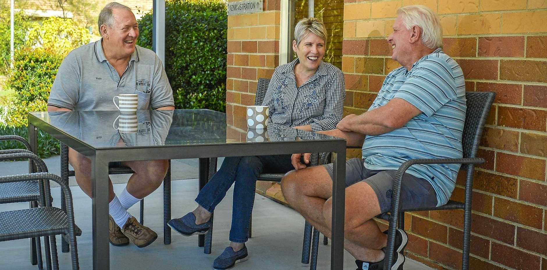 THROWING SHADE: Wade Hughes, Sharon Triffett and Neil Smith  under the new outdoor shelter.
