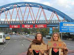 Protesters turn heads with bold statement on Pacific Highway
