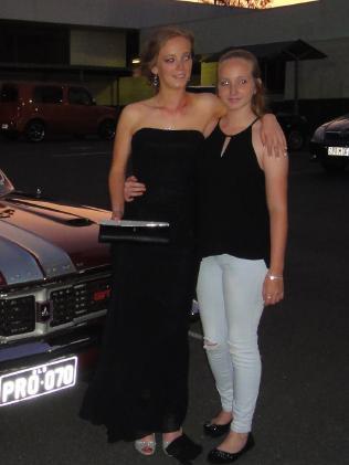 Larissa (right) and older sister Deanna.