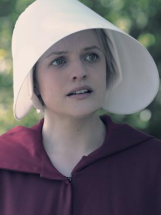 Elisabeth Moss as June.