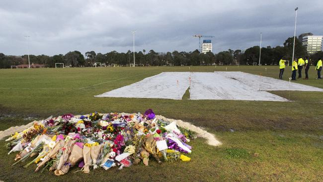 Council workers cover up graffiti painted at the memorial site of murdered Melbourne comedian Eurydice Dixon. Picture: Ellen Smith/AAP