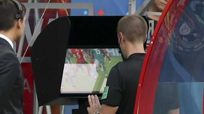 Referee Mark Geiger uses the VAR system during South Korea's clash with Germany. Picture: AP