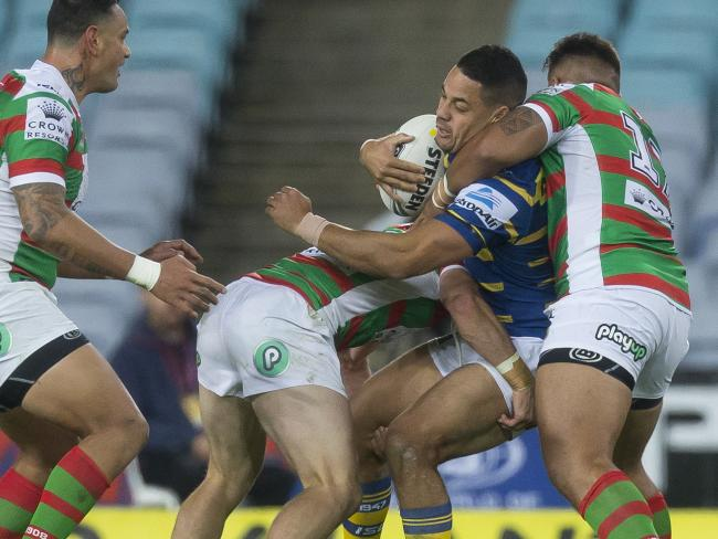 Jarryd Hayne is hammered by two Rabbitohs. Picture: AAP