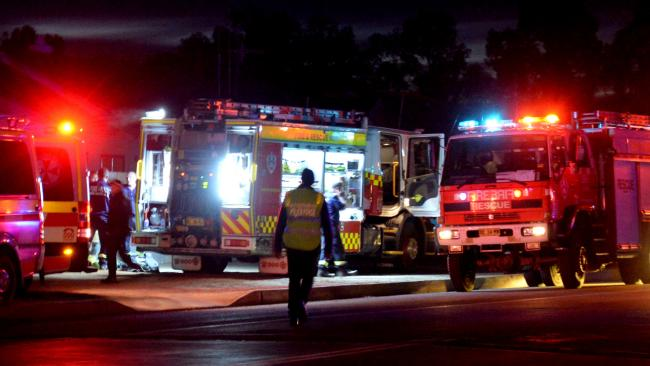 Emergency services attending the scene in Creedon Street, Broken Hill tonight where a man and his two sons have been found unconscious in a shed, 28 June 2018. Picture: Myles Burt.