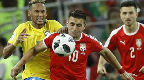 Dusan Tadic tries to get the better of Neymar. Picture: AP.