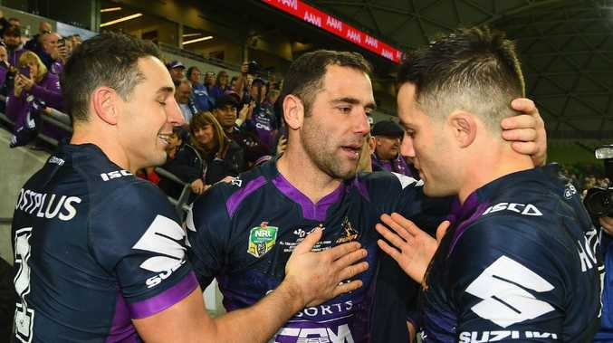 MELBOURNE, AUSTRALIA — SEPTEMBER 09: Cameron Smith of the Storm celebrates with Billy Slater and Cooper Cronk after winning the NRL Qualifying Final match between the Melbourne Storm and the Parramatta Eels at AAMI Park on September 9, 2017 in Melbourne, Australia. (Photo by Quinn Rooney/Getty Images)