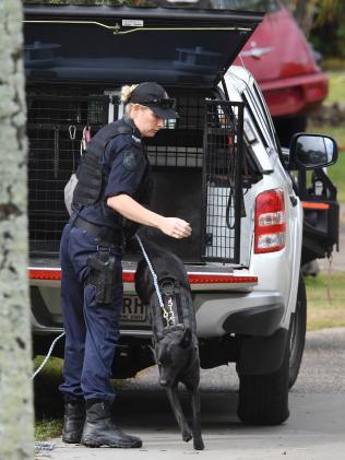 A police dog handler at the caravan park. Picture: Darren England.