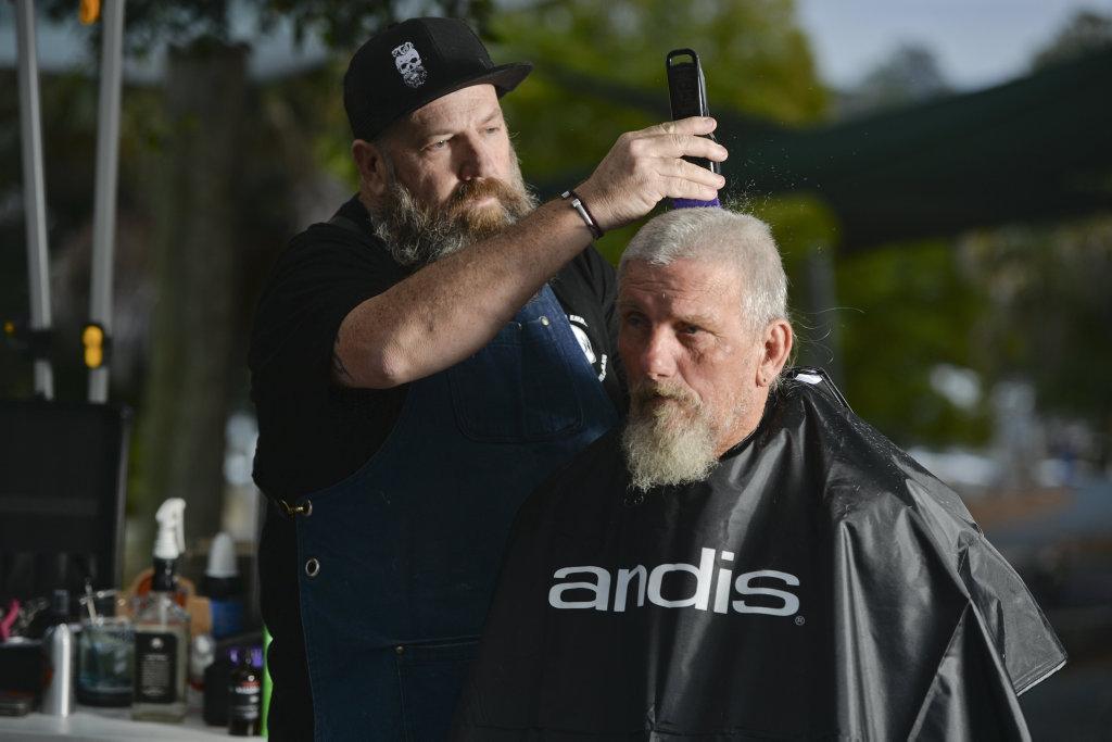 BARBER PARAMEDIC: BarberAid founder and paramedic Damian Roche cuts David Thomas' hair.