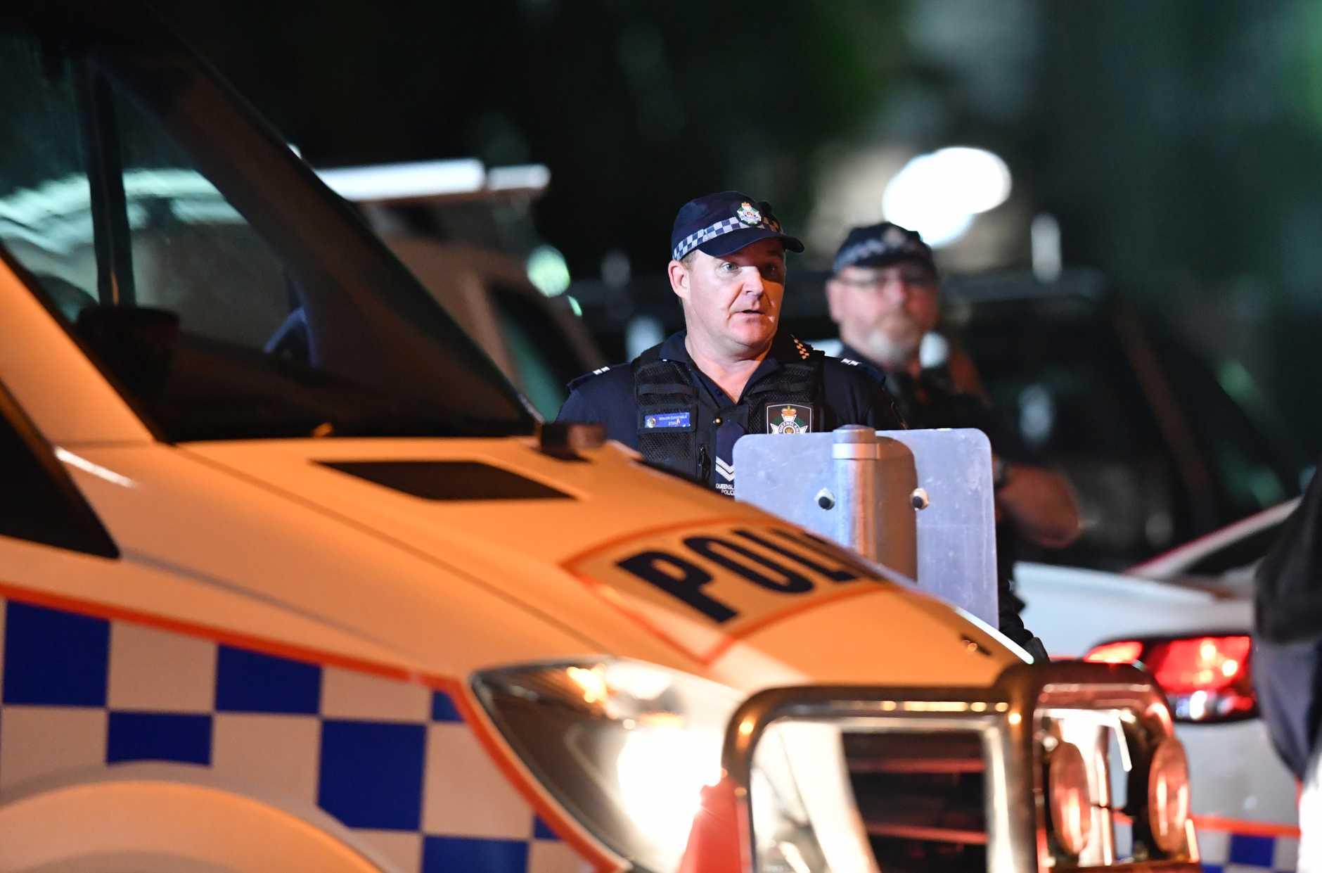 Police at the scene of the Alexandra Headland siege.