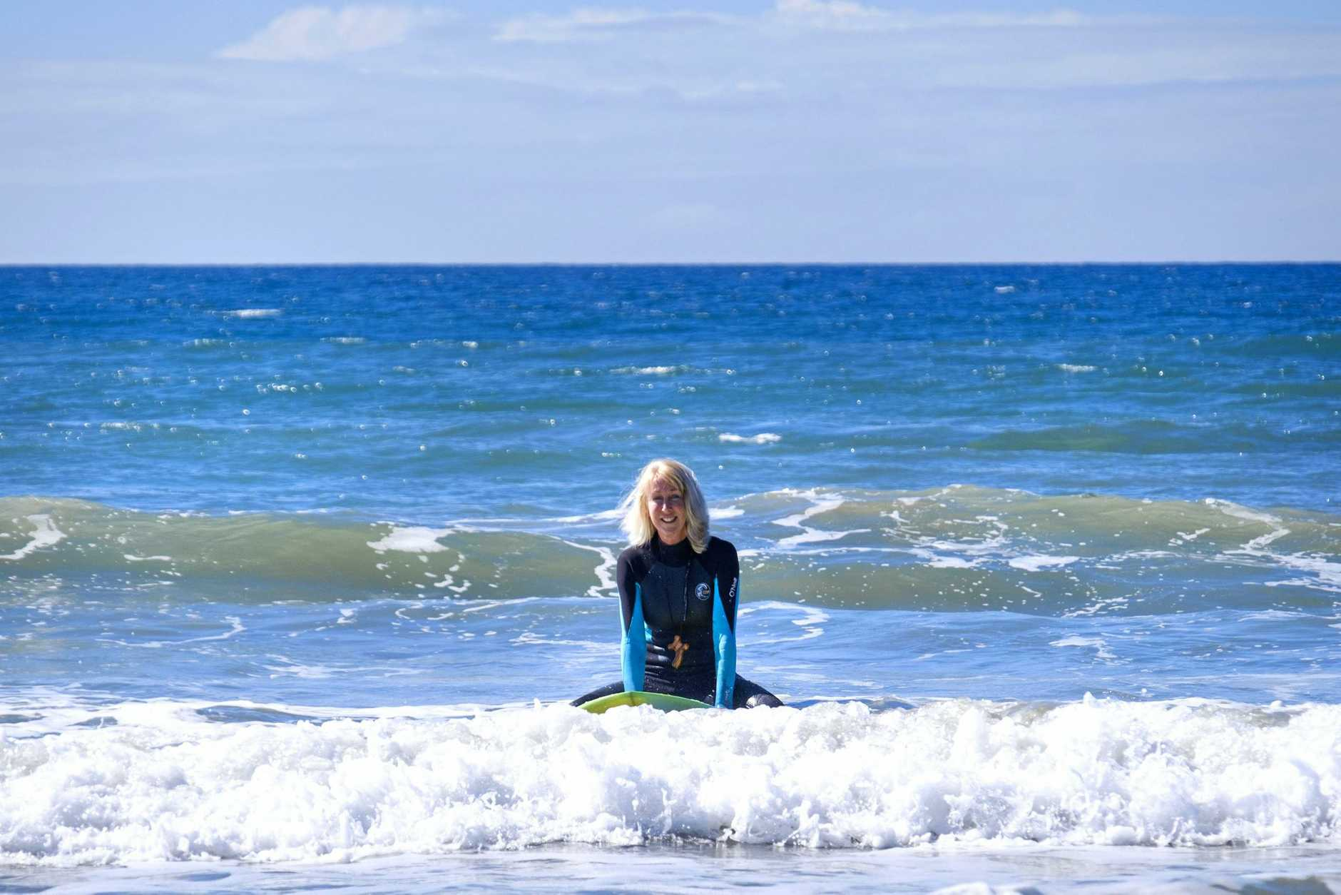 SURF'S UP: Reverend Jennifer Lynn and the Uniting Church staff are starting a surf service, and everyone's invited.