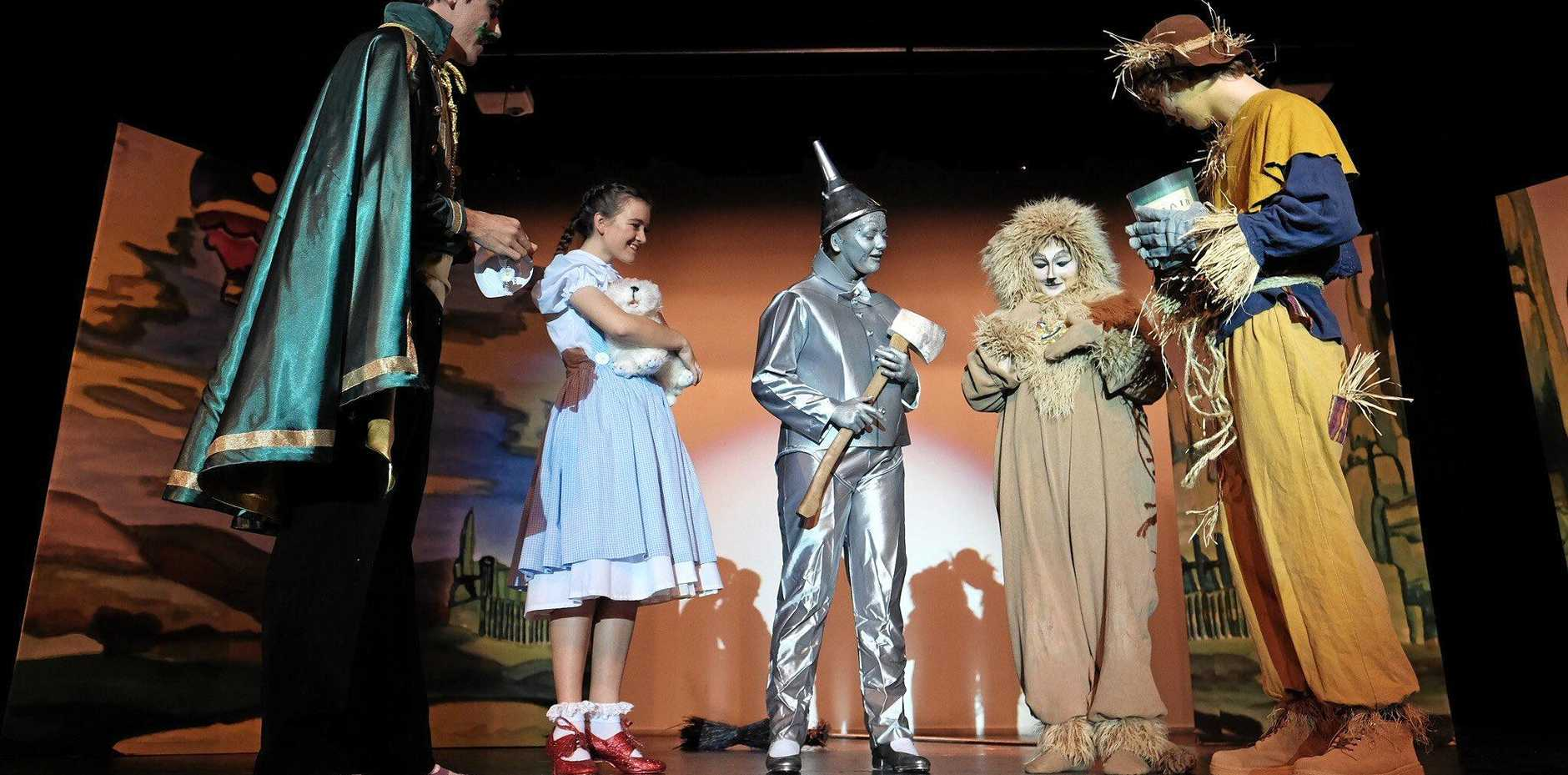 ROAD TO OZ: Marist students Lindsay Chapman (Wizard of Oz), Hannah Herwin (Dorothy), Abbie Hopkinson (Tinman), Hannah Ryan (Lion), Elijah Horsfall (Scarecrow) rehearse the musical. See page 12 for more photos.