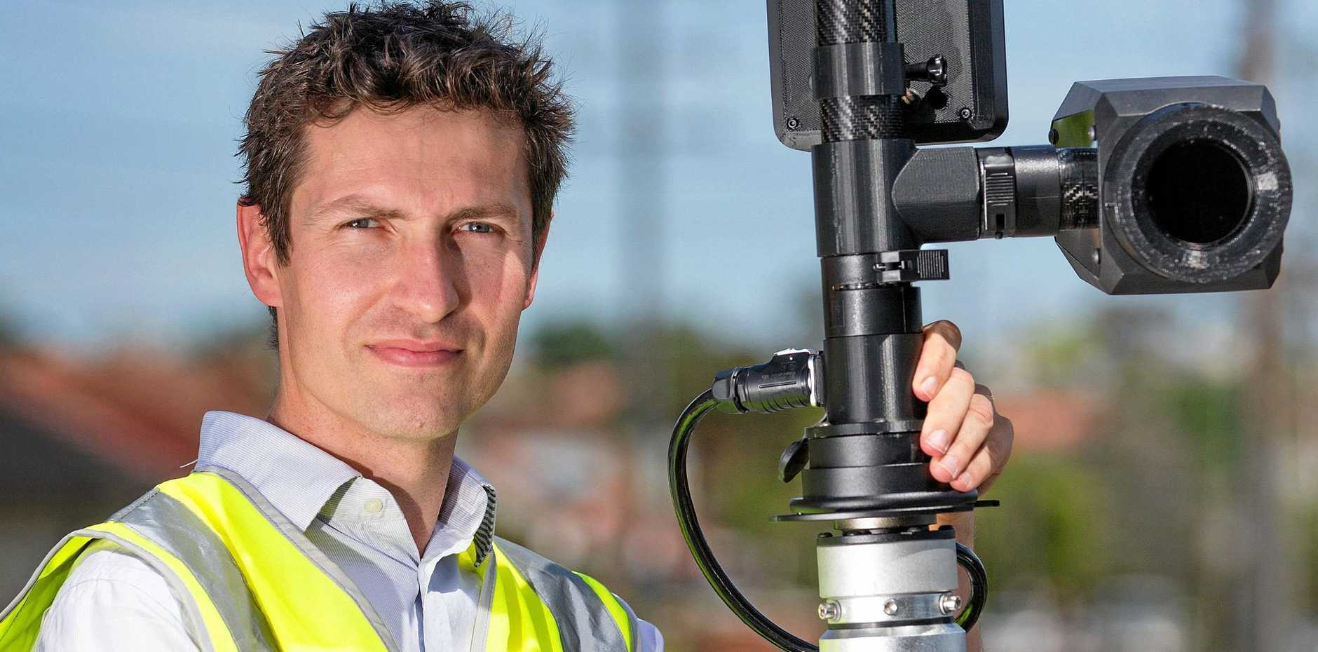 Alex McCredie with the cameras which can detect people using their mobile phones while driving.