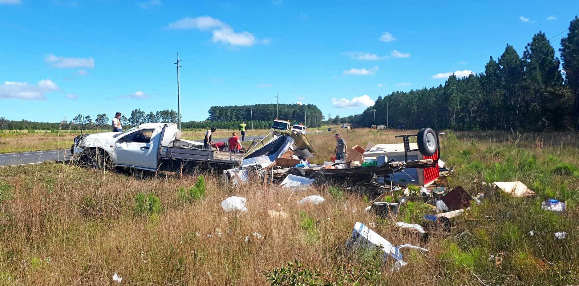 A ute towing a caravan has come to grief on the Tin Can Bay Rd near Tinana.