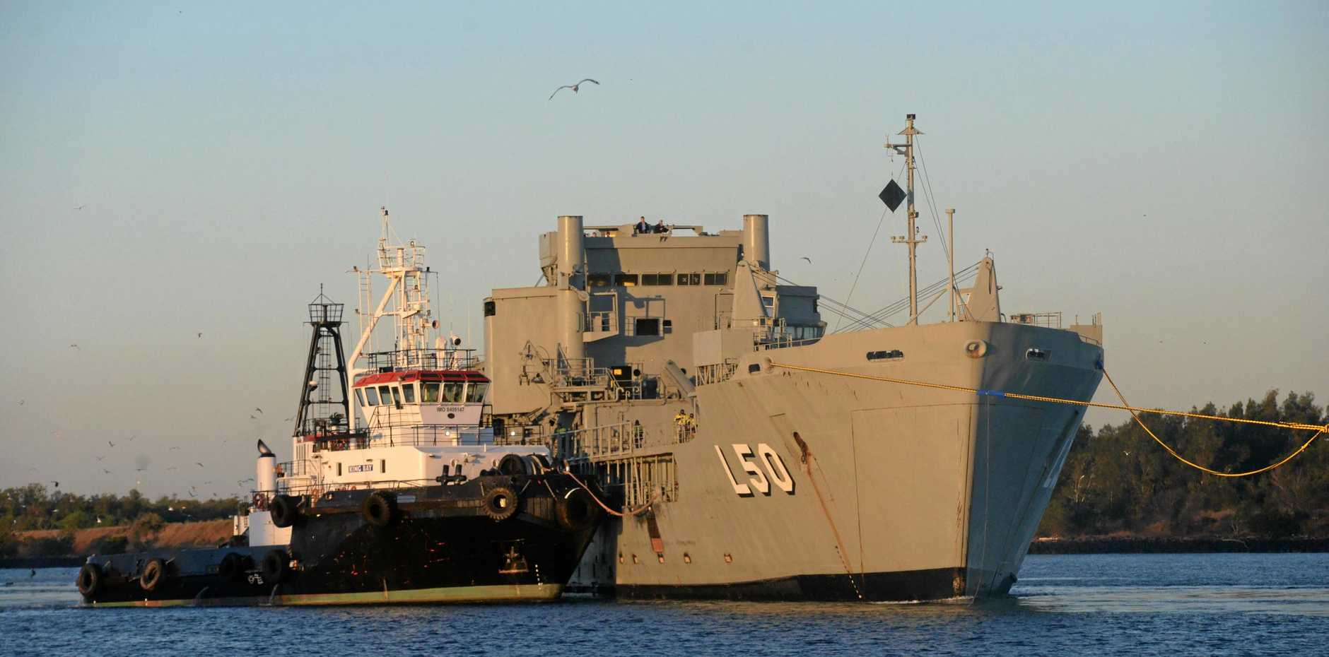 FINAL GOODBYES: ex-HMAS Tobruk leaves Bundaberg Port on her way to her final resting place off the coast of Wide Bay.