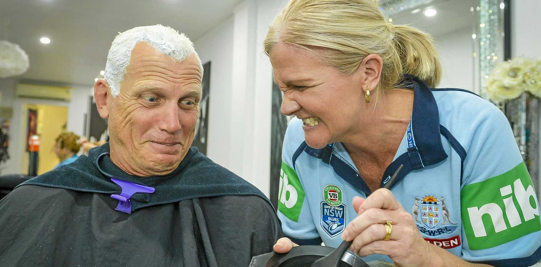 Queensland state of origin legend and Tannum Sands resident, Gary Larson has dyed his hair blue following New South Wales' state of origin win, after losing a bet with longtime friend Lisa Emmert.