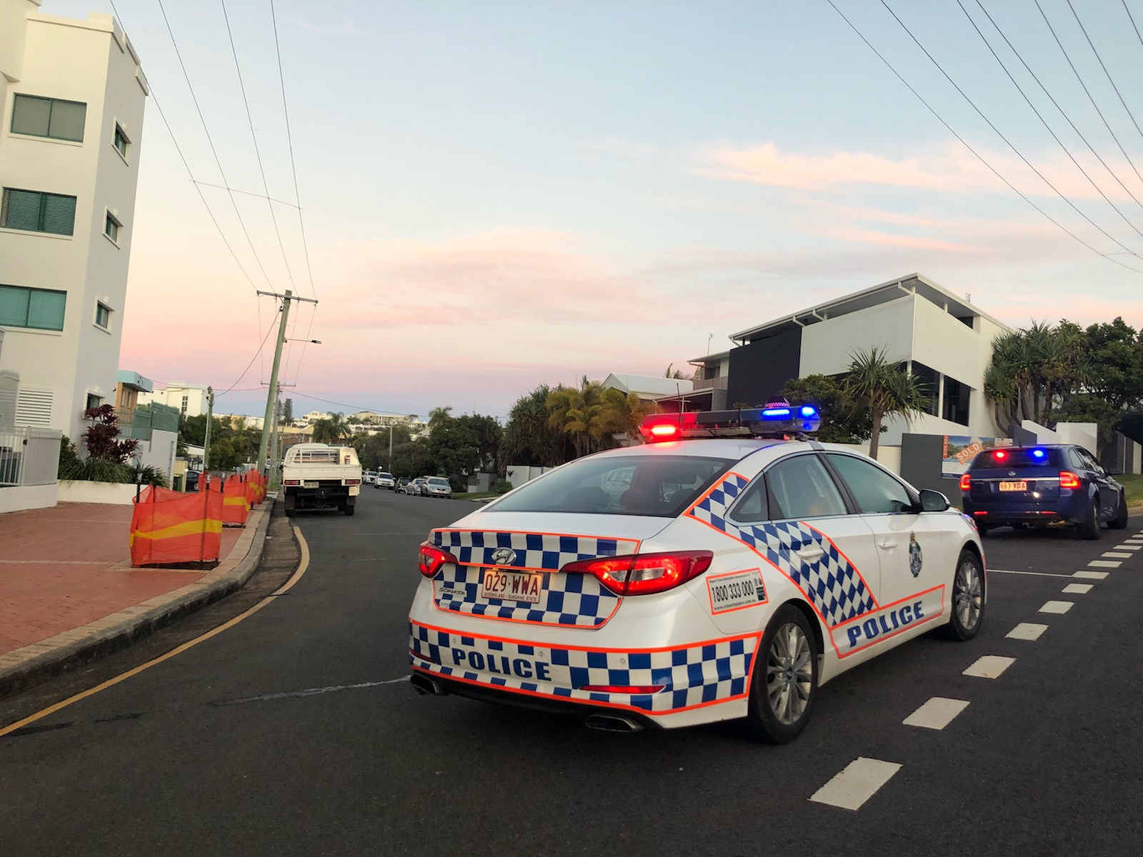 Police have locked down a street on the Sunshine Coast after they cornered the suspect in the body in a barrel murder.