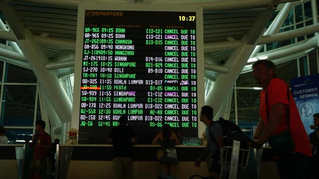 A volcanic explosion at Mt Agung threw Bali's Denpasar Airport into chaos.  Picture: Komang Erviani