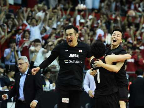 Japan celebrate their stunning upset. Picture: Getty