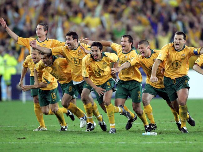 The Socceroos celebrate after John Aloisi kicks a winning penalty goal to send them to the 2006 World Cup.