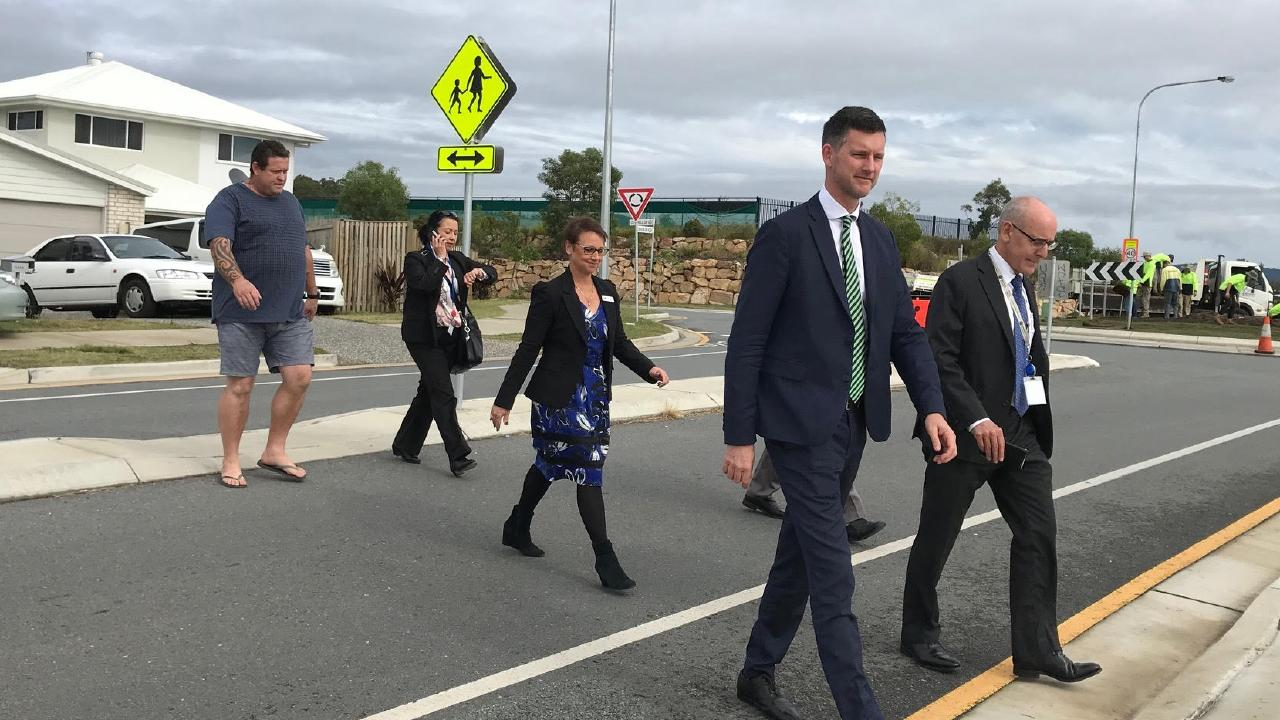 Transport Minister Mark Bailey and TMR staff survey the road surrounding Pimpama State College Primary with Principal Donna Gosling and parent Doug Kirby