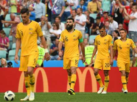 Dejected Australian players trudge off after their 2-0 loss to Peru consigned them to last place in Group C. Picture: Dean Lewis/AAP