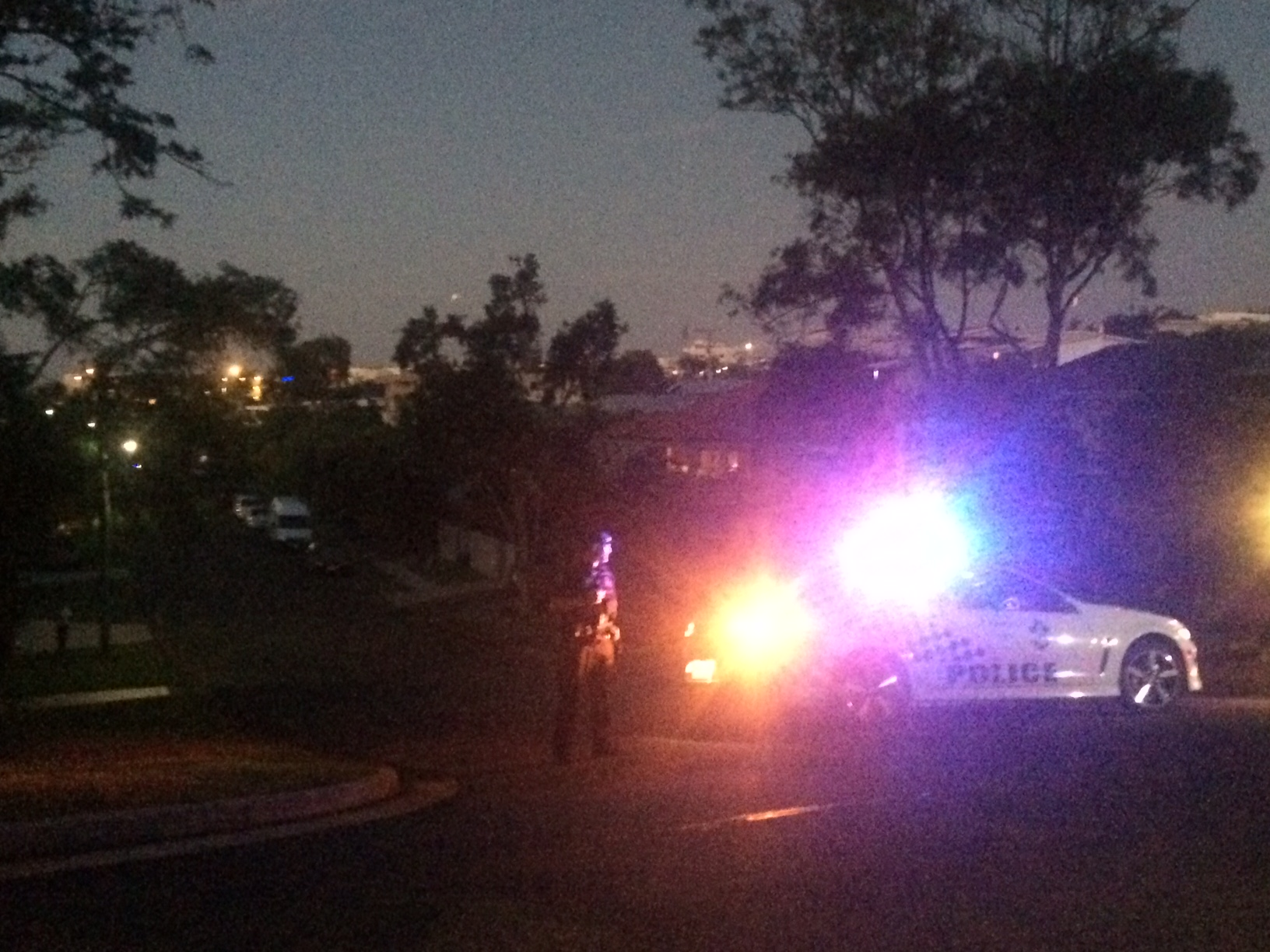 Police at the intersection of William and Mary Sts, Alexandra Headland.